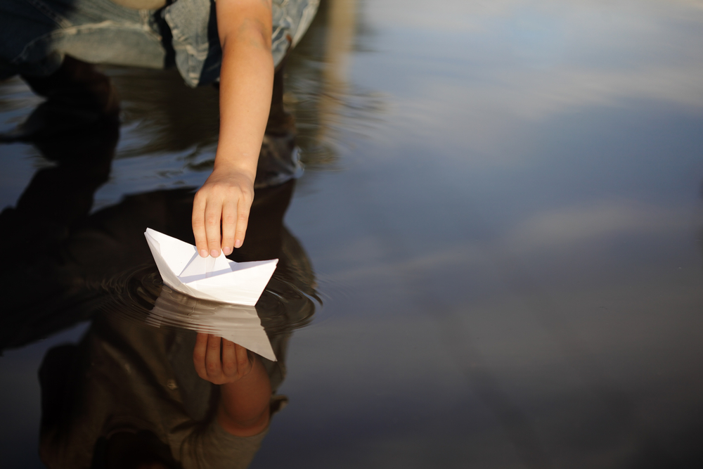 paper-ship-in-water