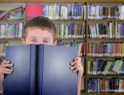 a-boy-with-a-book-in-library