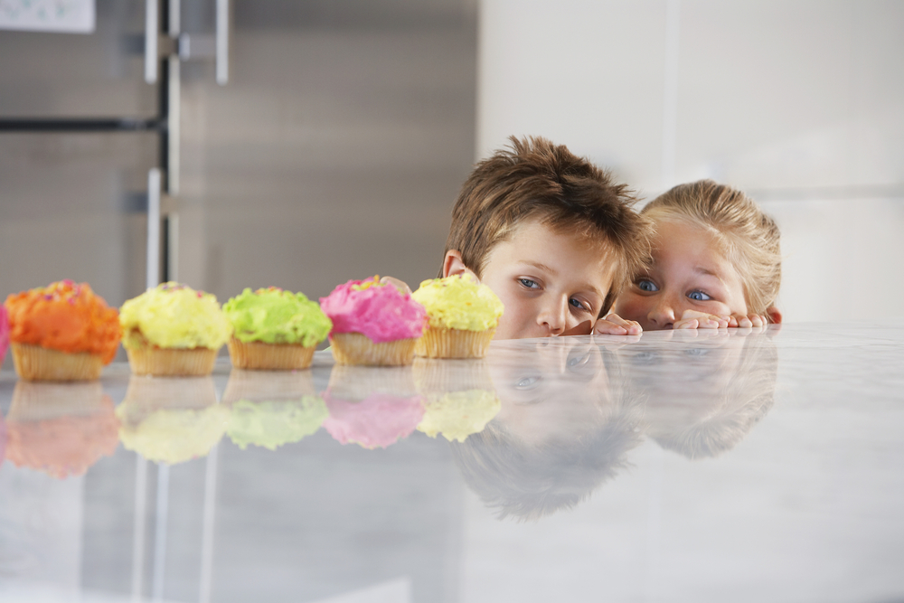 children-looking-at-cupcakes