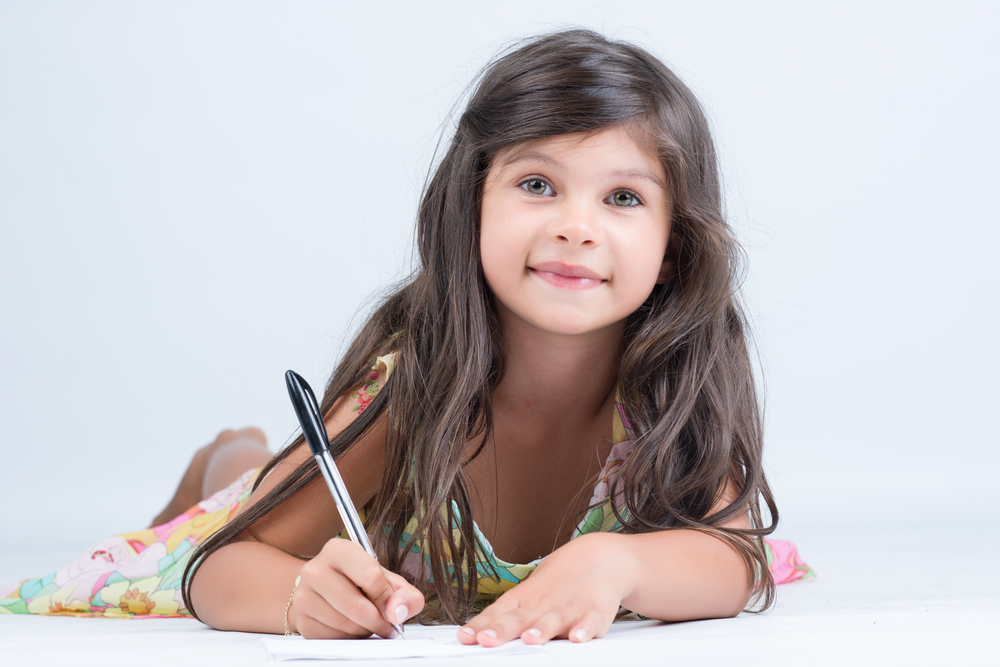 cute-girl-writing-a-letter