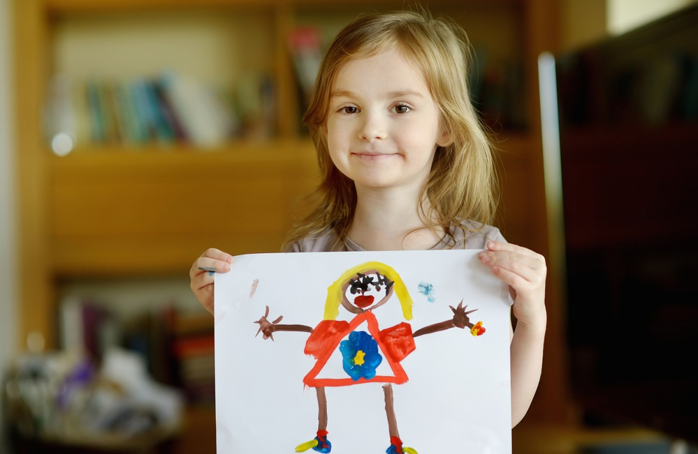 girl-holding-her-painting