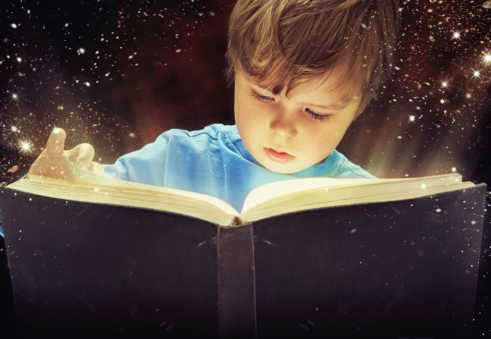 boy-reading-book-of-magic