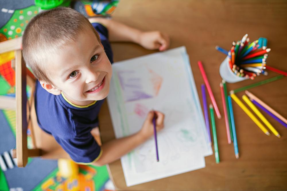 boy-smiling-drawing