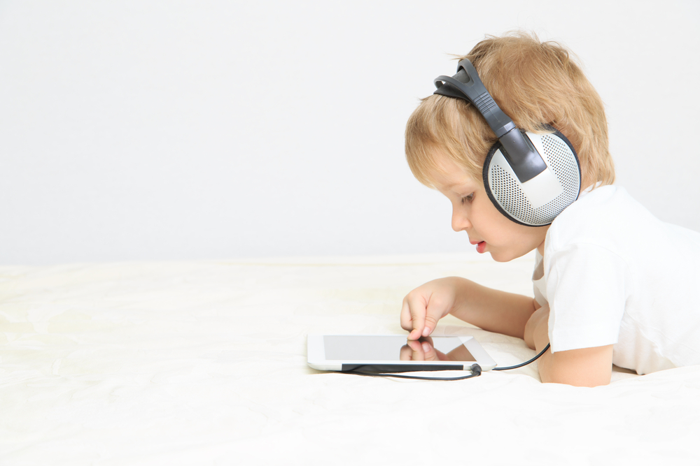 boy-with-headphones-and-tablet