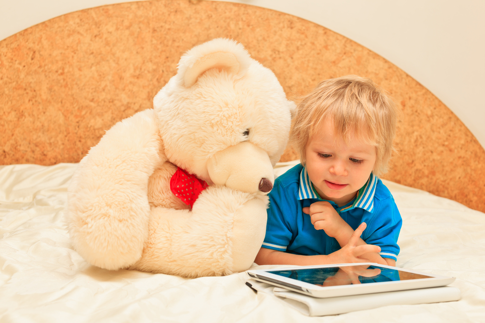 boy-with-teddy-bear-and-tablet