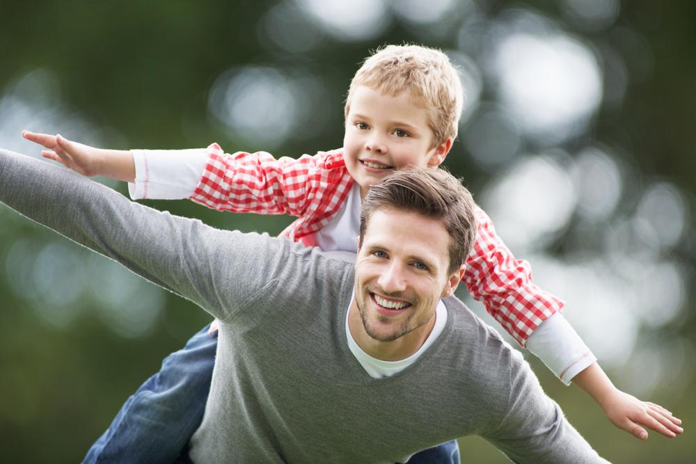 father-giving-his-son-piggyback