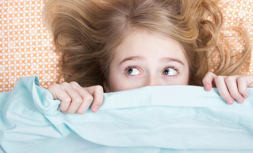 girl-hiding-under-sheets