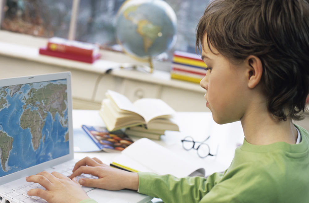 Boy-using-laptop-for-studying