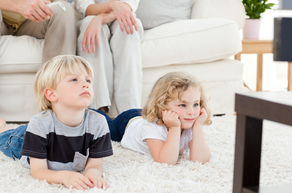 adorable-family-watching-tv-in-the-living-room