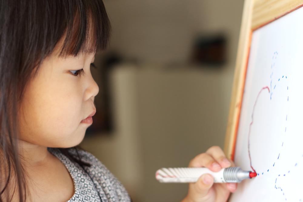 asian-girl-on-whiteboard