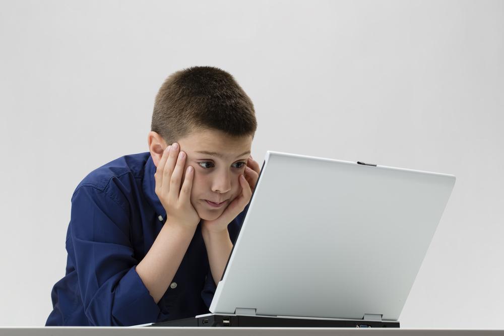 boy-looking-in-computer-screen