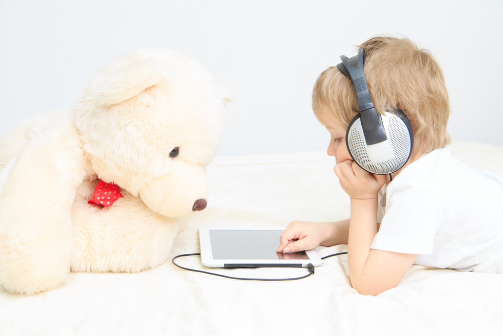 boy-with-headset-using-touchpad