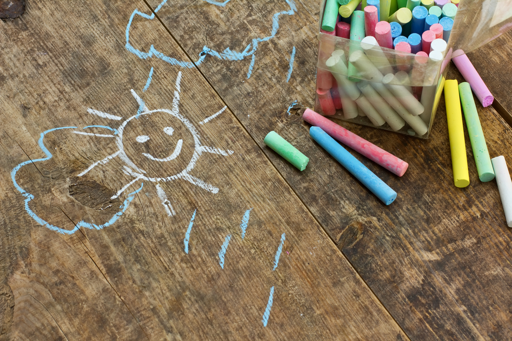 chalk-drawings-on-wooden-table