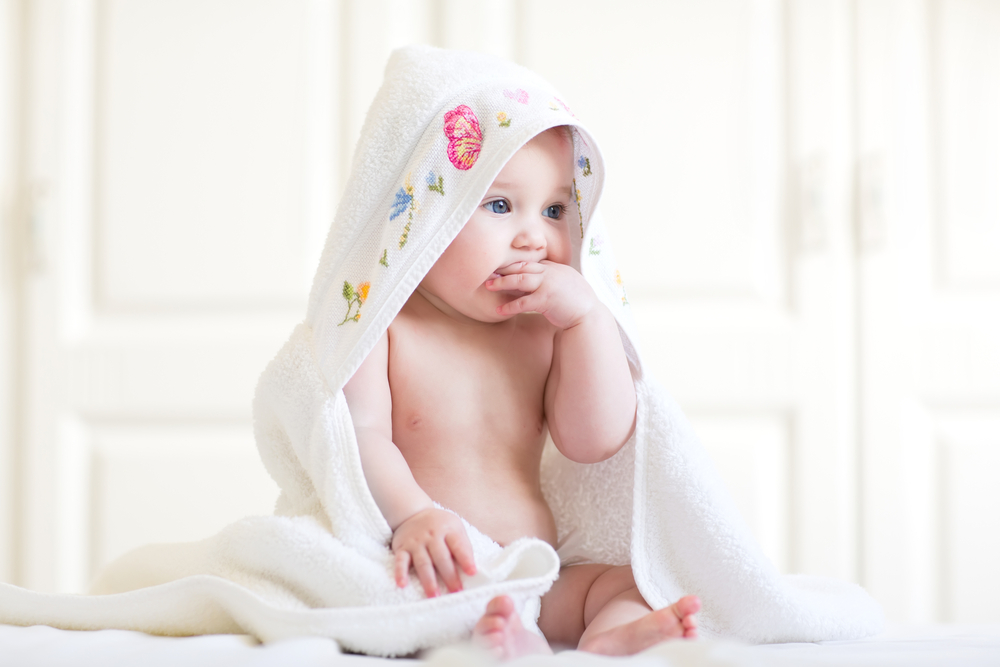 cute-baby-girl-wrapped-up-in-her-blanket