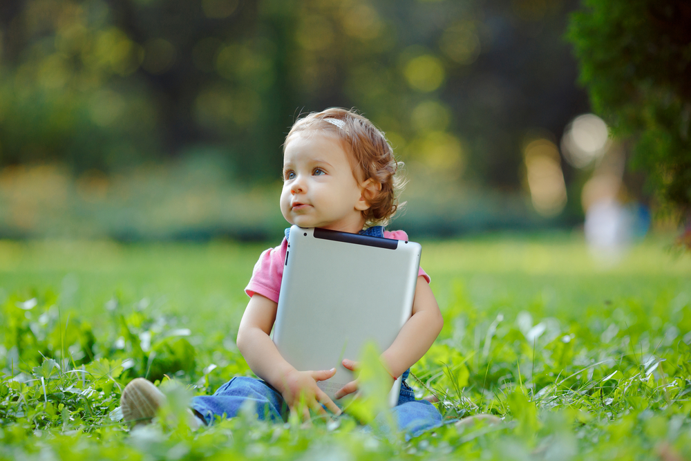 cute-baby-in-the-park-with-tablet