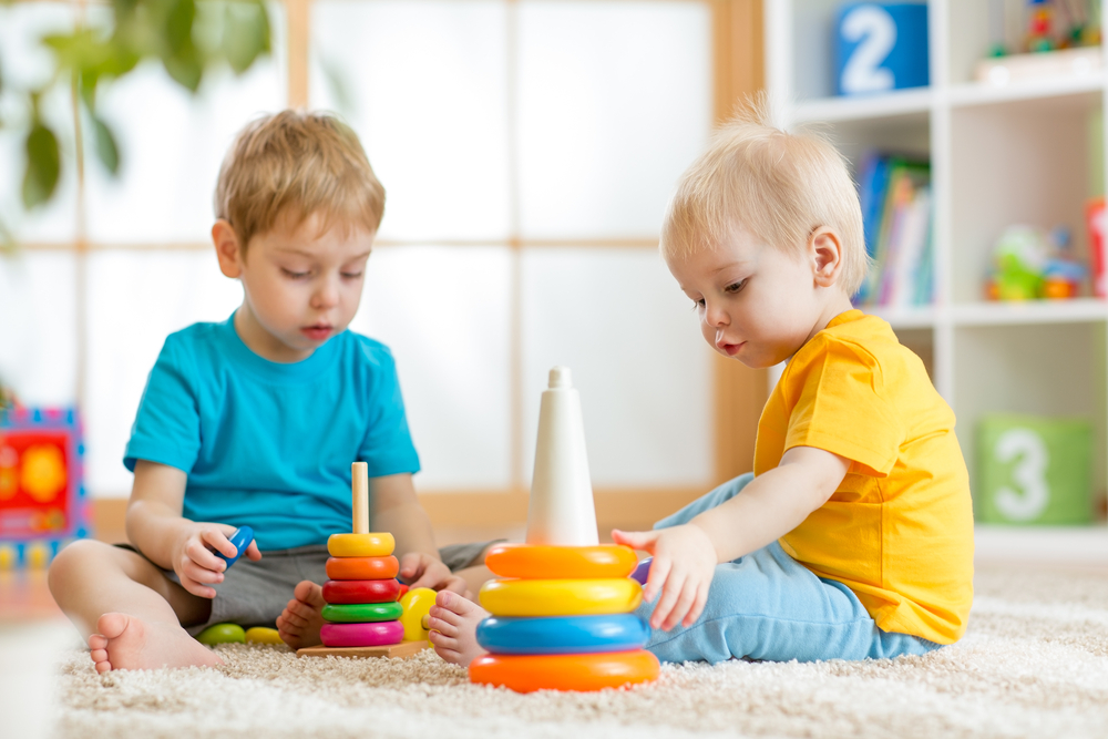 cute-toddlers-playing-indoors