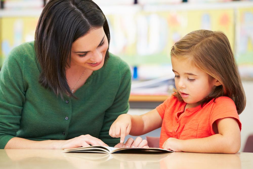 female-teacher-helping-her-student