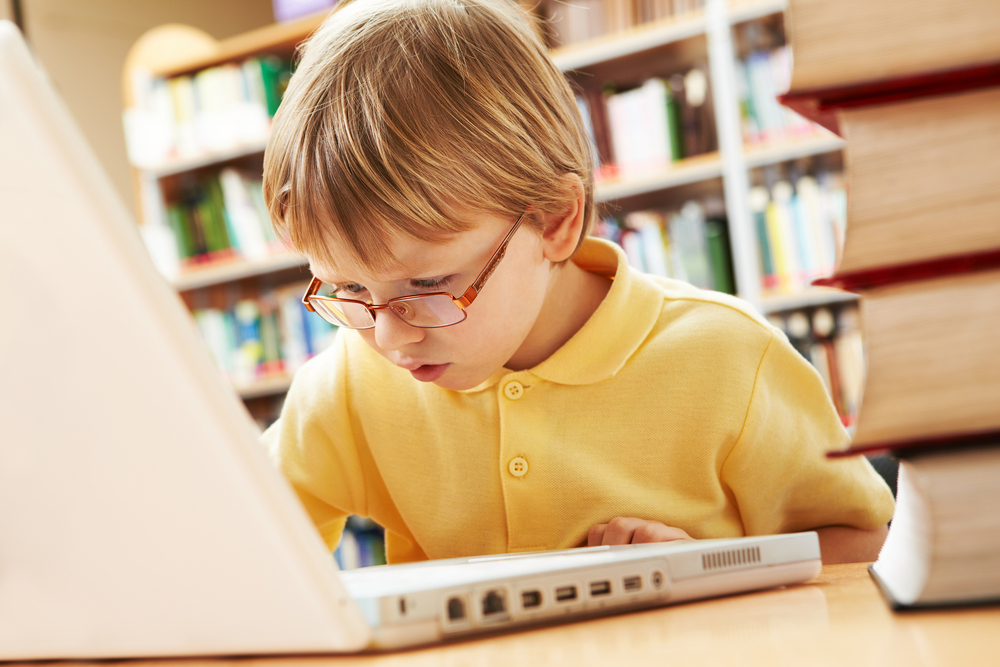 kid-using-his-laptop-in-public-library