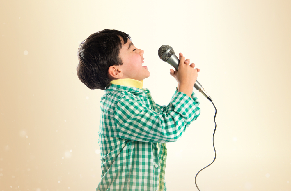 little-blackhaired-boy-singing