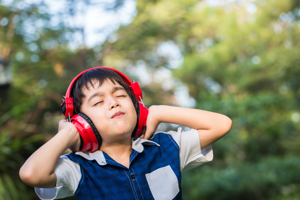 little-boy-with-headset=in-park