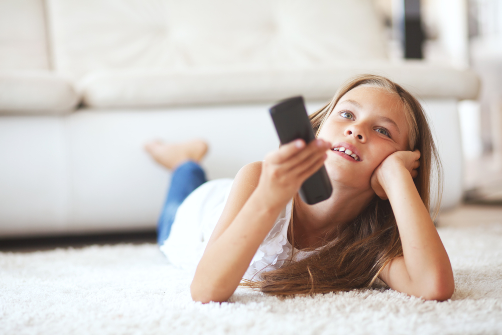 little-girl-holding-remote