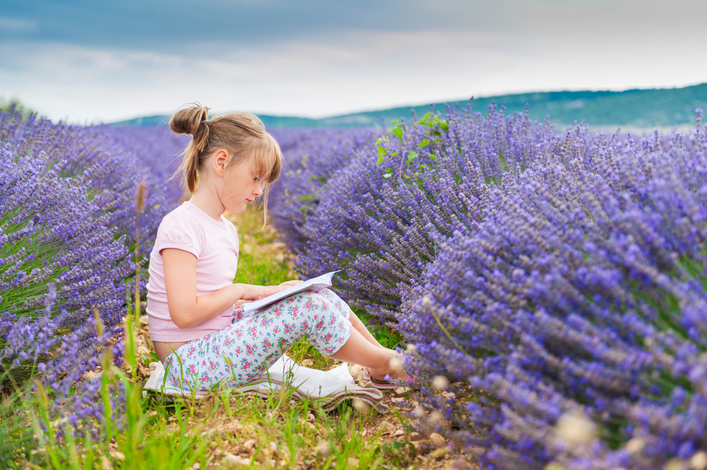 little-girl-reading-a-book-in-a-lavender-field