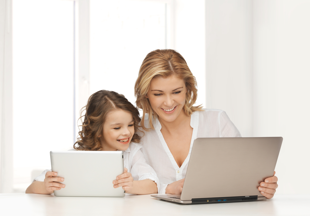 mom-and-daughter-using-laptops