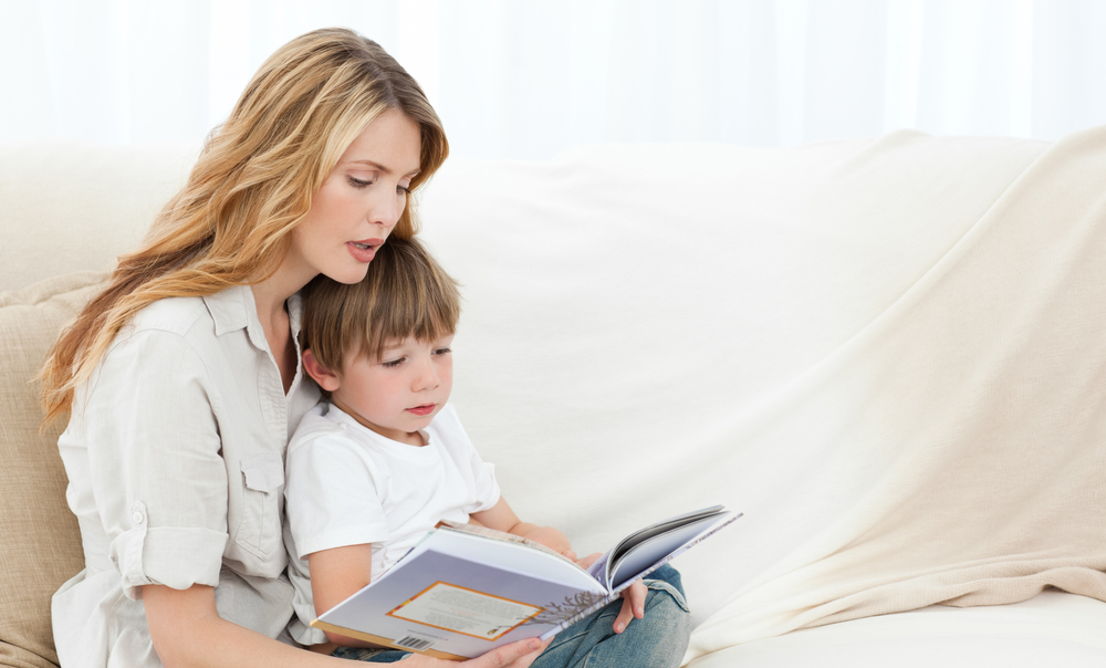 mother-with-her-son-on-sofa-reading