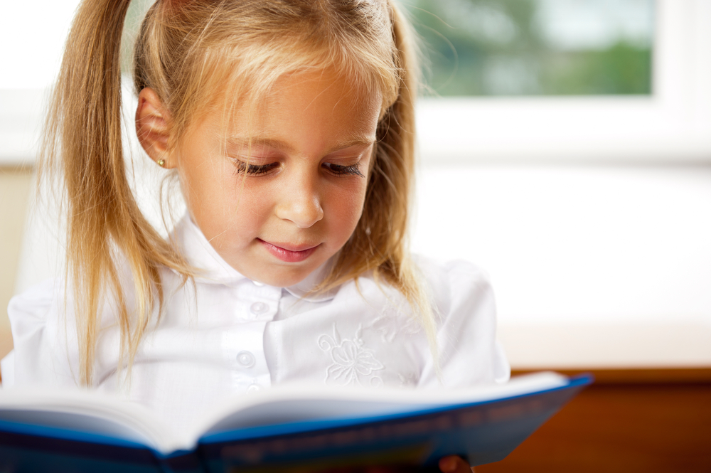 smart-girl-reading-in-class