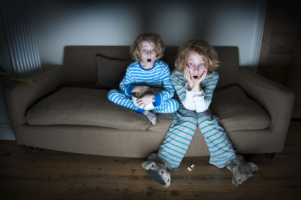 two-boys-scared-watching-TV