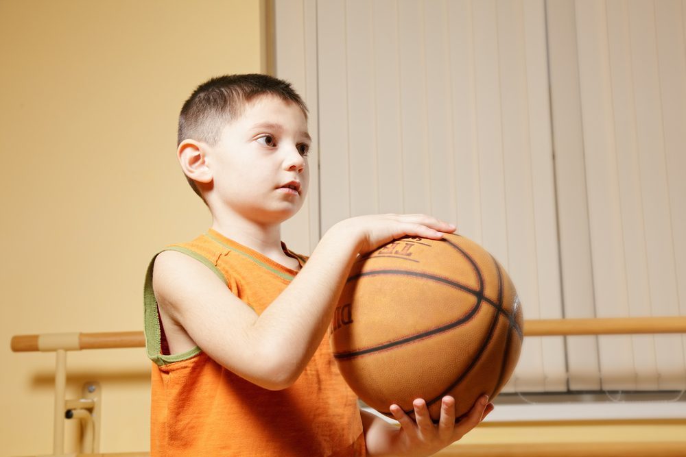 boy-holding-basketbal-ball