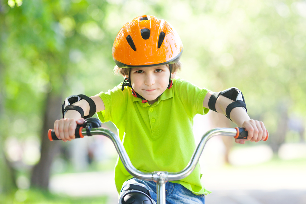 the-boy-in-the-protective-helmet-for-bike