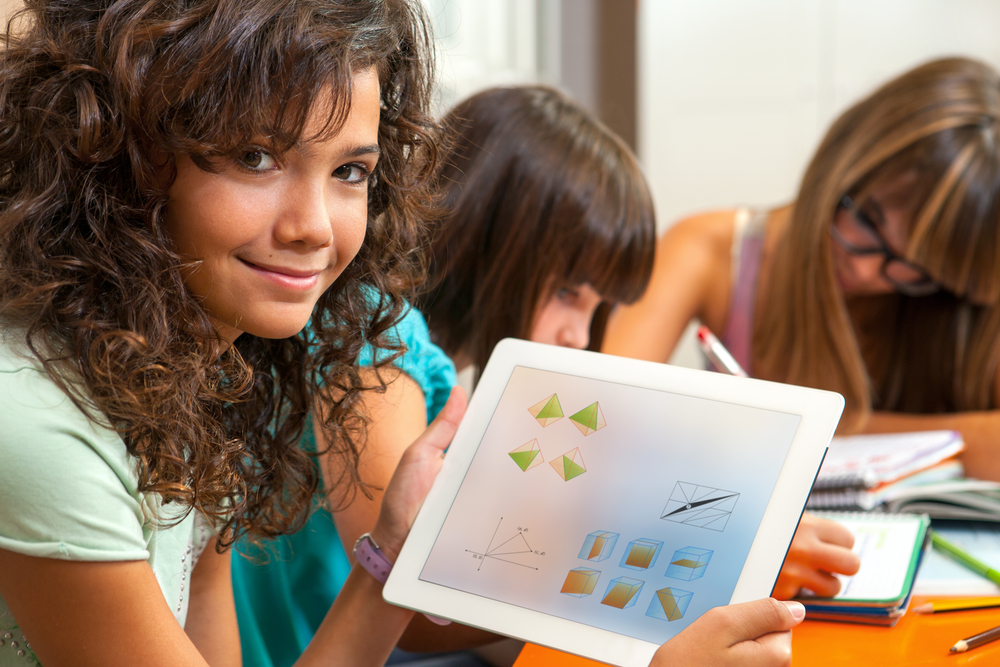 close-up-of-a-student-holding-tablet-with-homework