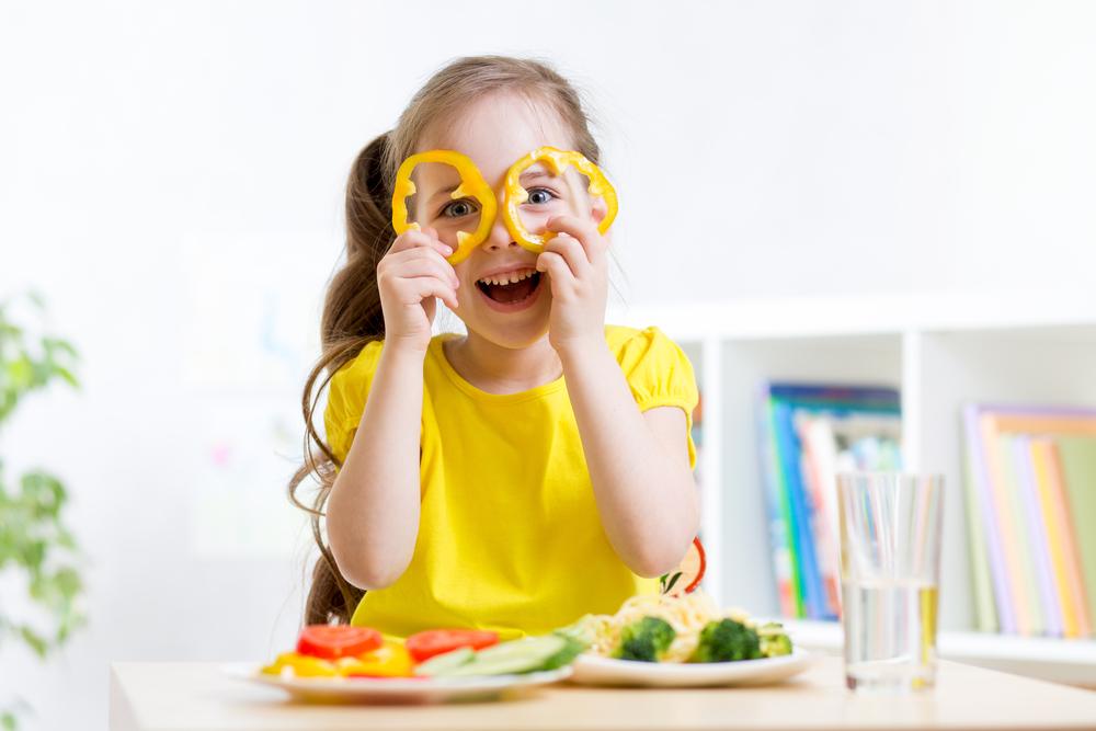 girl-eats-vegan-food-having-fun-in-kindergarten