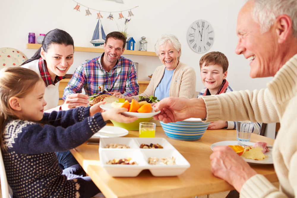 multi-generation-family-eating-lunch-at-kitchen-table