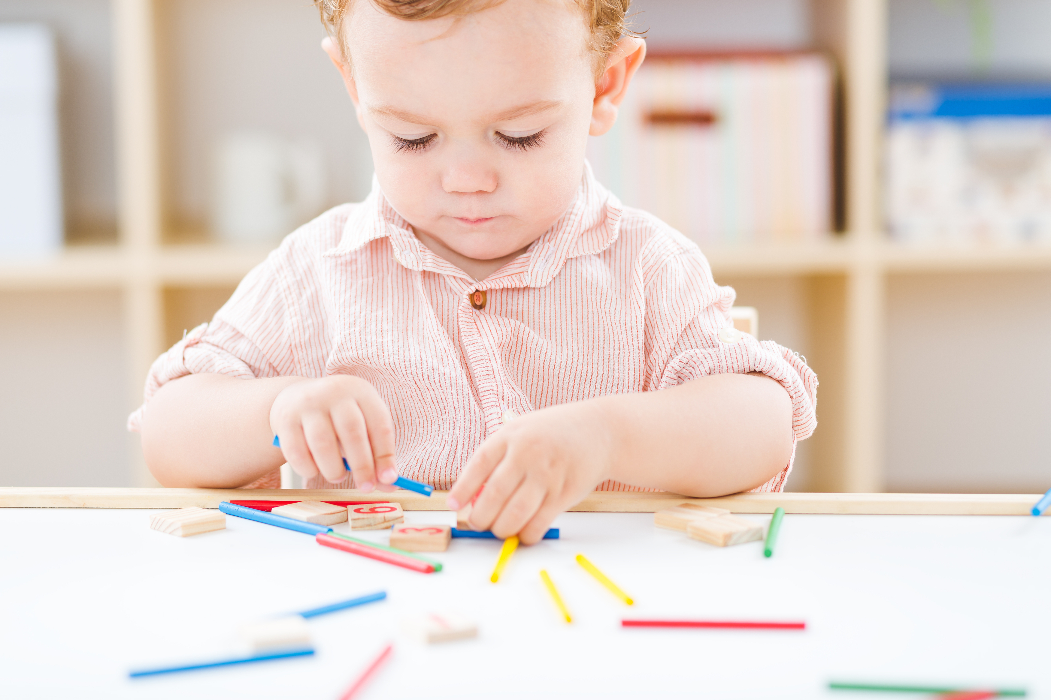 cute-little-boy-playing-numbers-sticks