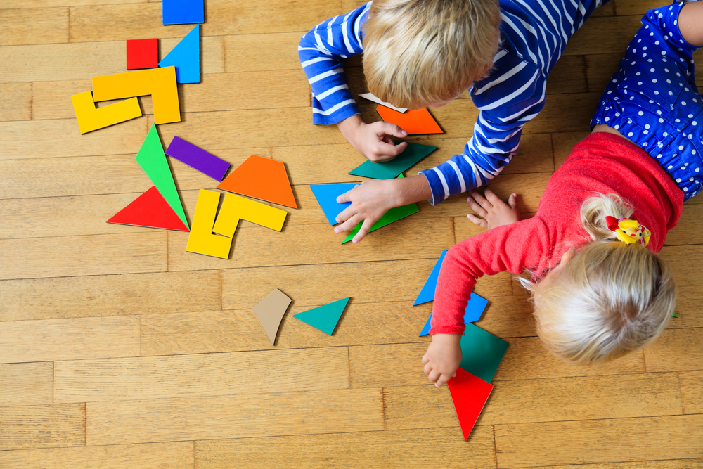 little-boy-girl-playing-geometric-shapes
