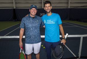 The Novak Djokovic Foundation Lottery winner, Dave WIlls, and Novak Djokovic